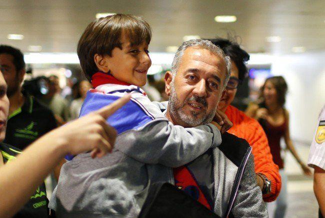 Osama Abdul Mohsen mit seinem Sohn Zaid in Madrid.