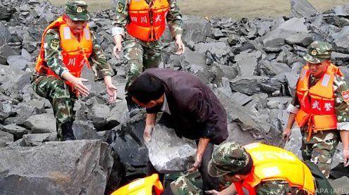 Mindestens 141 Personen werdennach Erdrutsch in China vermisst