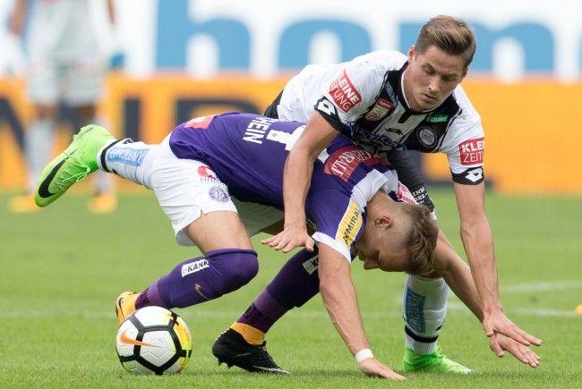 vlnr.: Christoph Mondschein (FK Austria Wien) und Thorsten Röcher (SK Sturm Graz) beim Spiel