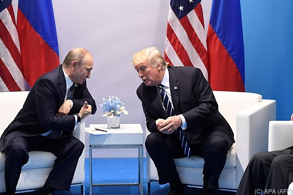 Russlands Präsident Putin mit US-Präsident Trump