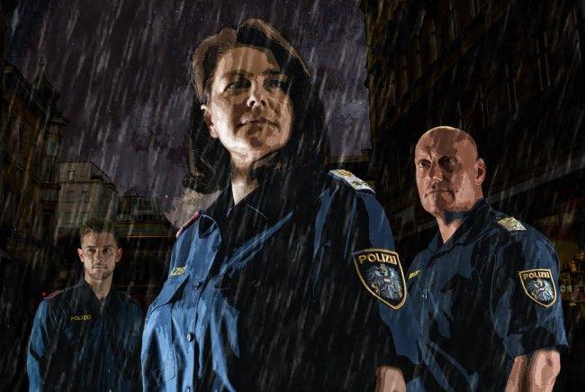 """Karin und Christian, bekannt vom """"Wachzimmer Ottakring"""", prangen am Polizeikalender-Cover"""